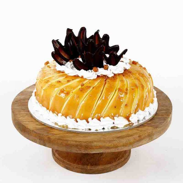 Round shaped pineapple cake decoreted with brown chocolates