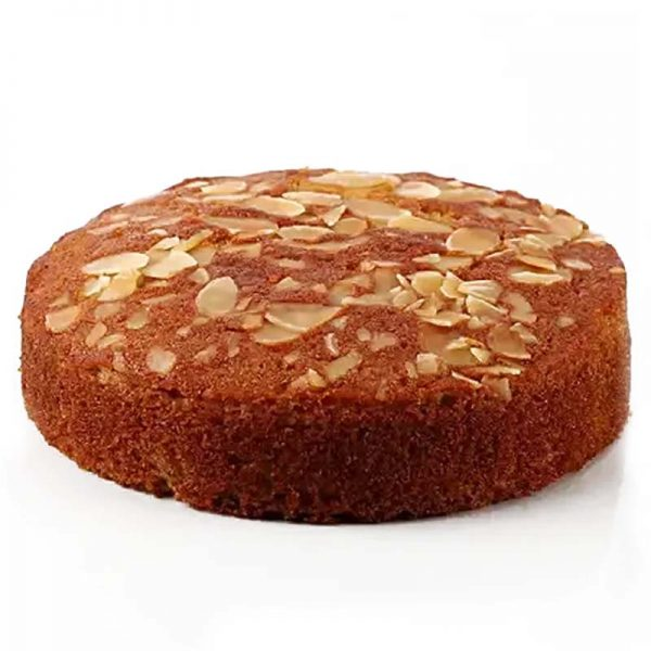 Round shaped vanilla dry cake with dryfruits on its top